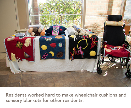 blankets and wheelchair cushions that were made by residents are on display