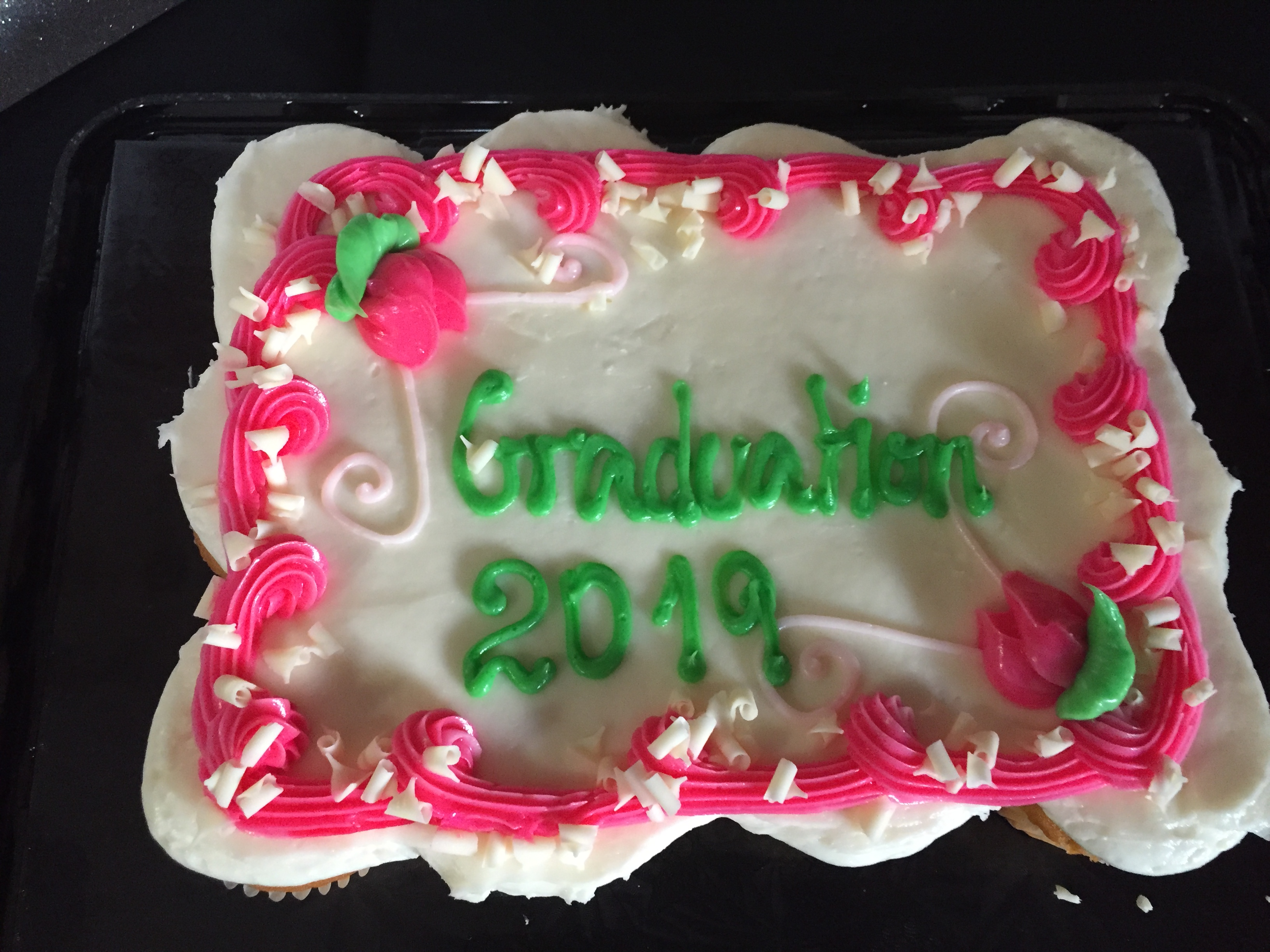 cake that says graduation 2019 on it