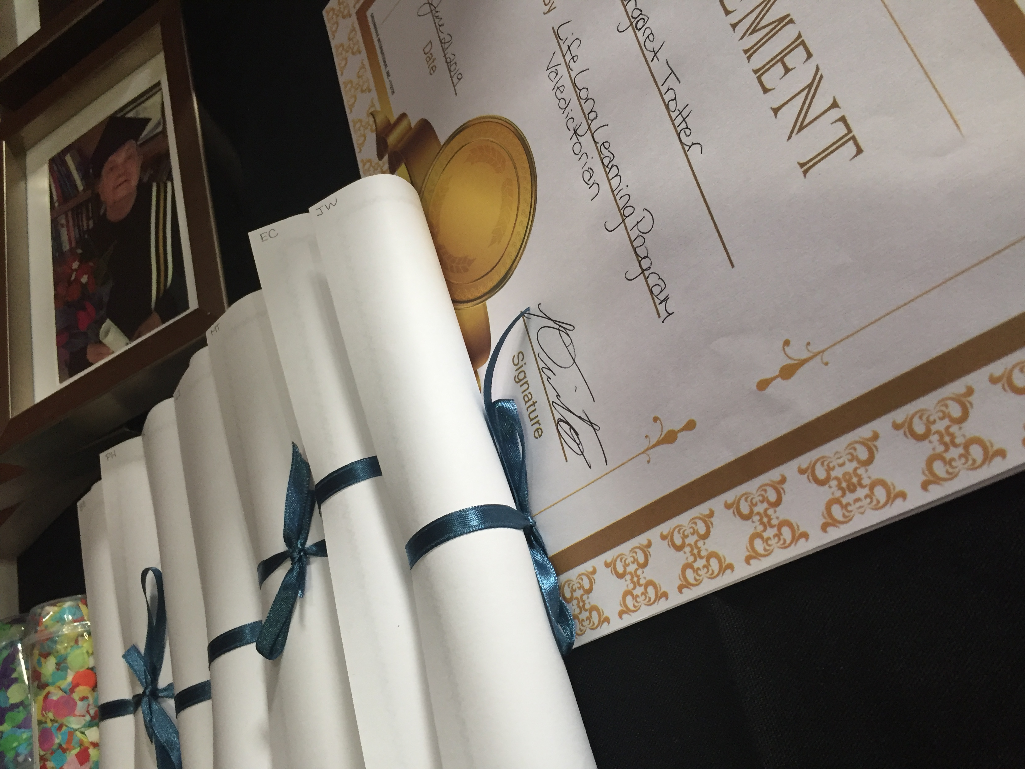 image of diplomas and grad certificates