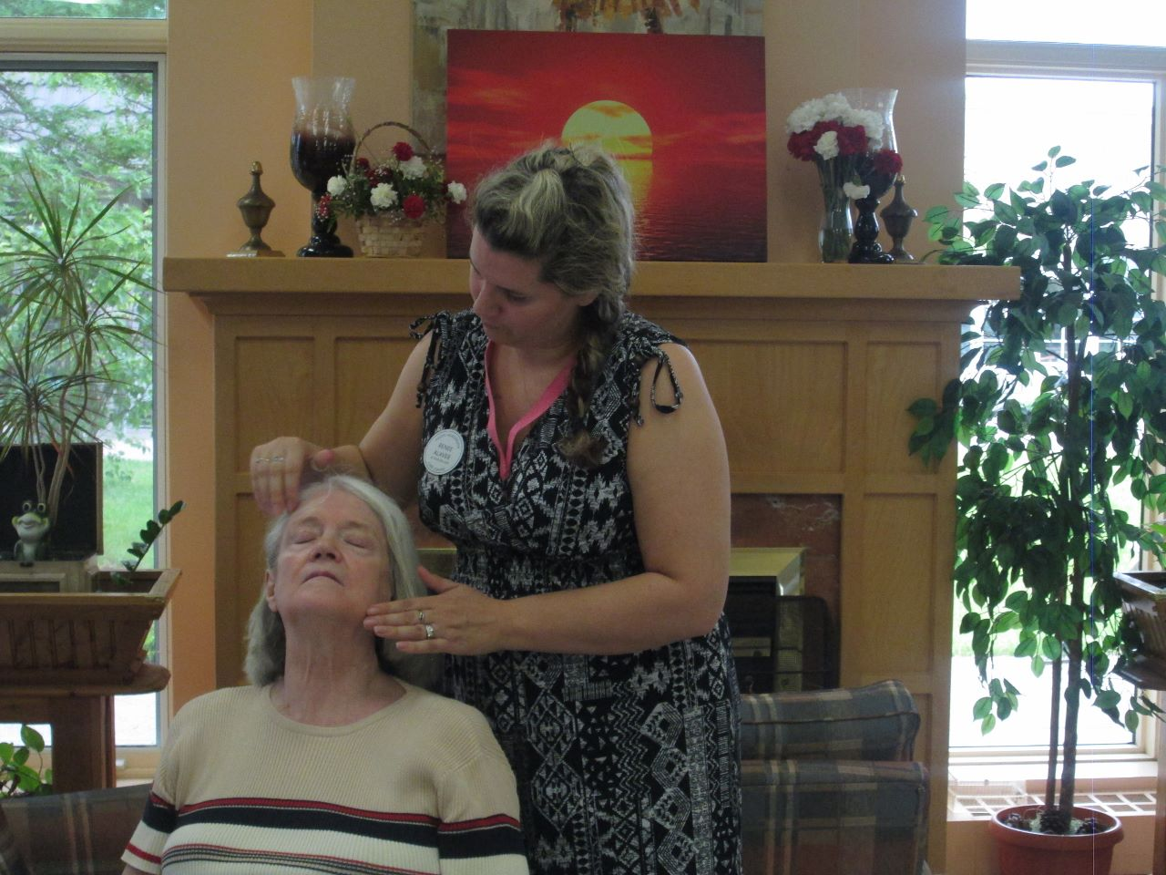 Resident Leslie Rae in getting her hair done by staff member Renée Alaver