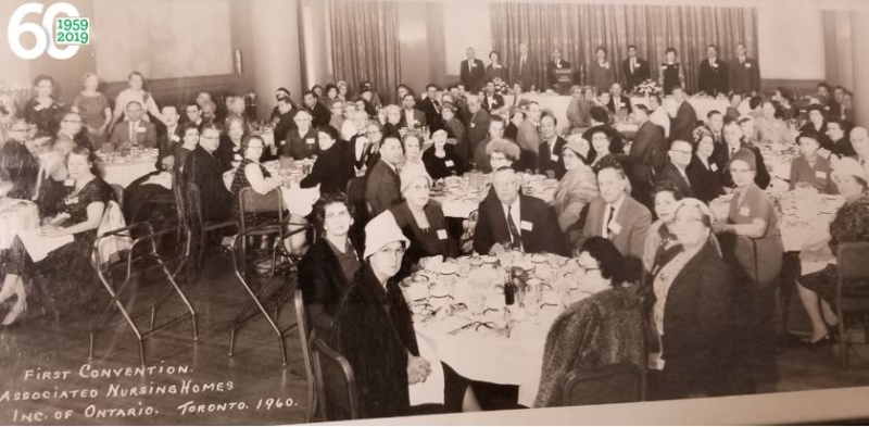 group of people sitting at tables, black and white photo from OLTCA's first convention in 1960
