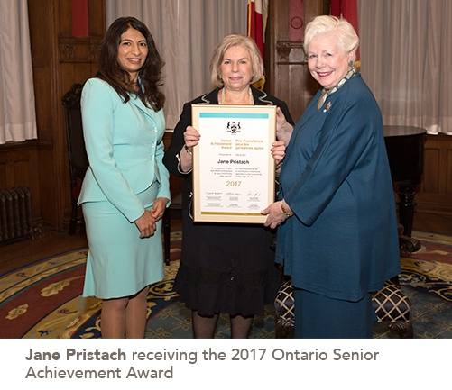 Jane Pristach stands in the centre holding her award, joined on one side by Seniors Affairs Minister Dipika Damerla and on the other by Lt.-Gov. Elizabeth Dowdeswell