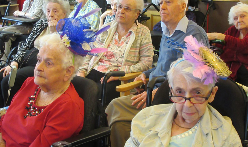 Residents are pictured wearing fascinators while watching the wedding