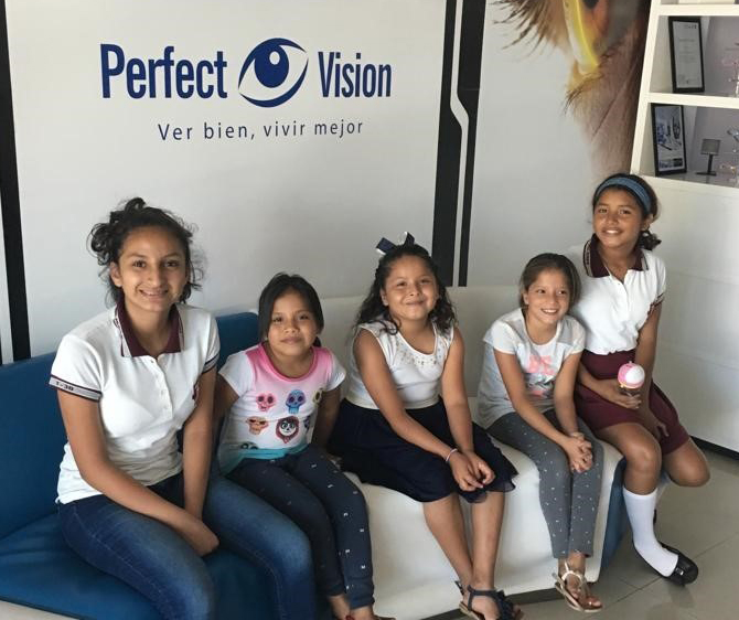 young girls pose in the optometrist's office