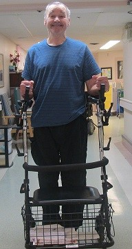 Jim stands with his walker