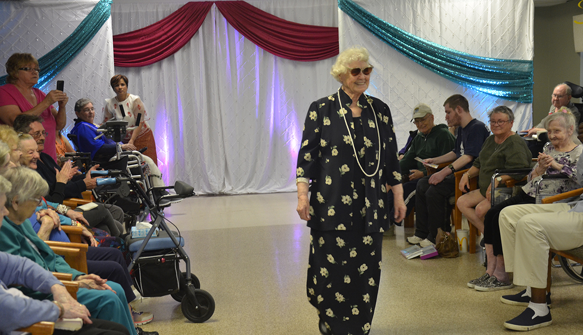 Resident Marion walks down the runway wearing fashions from Canada