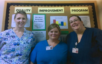 3 staff members from Twin Lakes' quality team smile for the camera